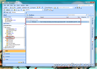 Outlook Outbox showing Scheduled Email