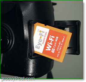 pictures of a eye-fi sdhc card going into a camera