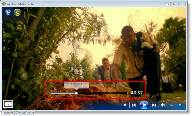 Windows 7 Media Center - use the slider bar to skip ahead or rewind quickly