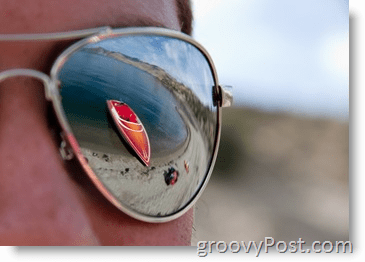 Photograph - Aperture Example - Sunglasses with Skiboat reflection red
