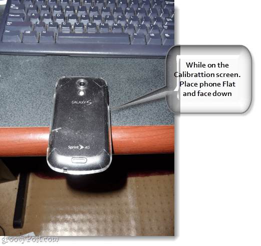 pictured is a samsung galaxy epic 4g hanging halfway off of a desk