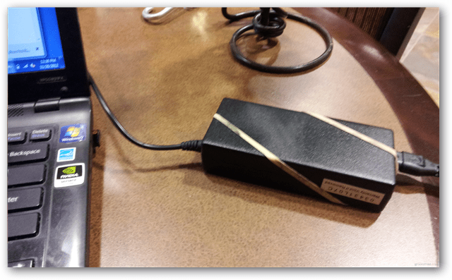 rubber band on laptop power brick
