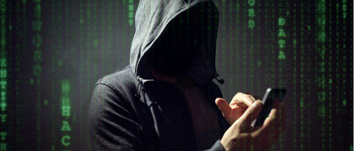 computer-hacker-with-mobile-phone-picture-feature
