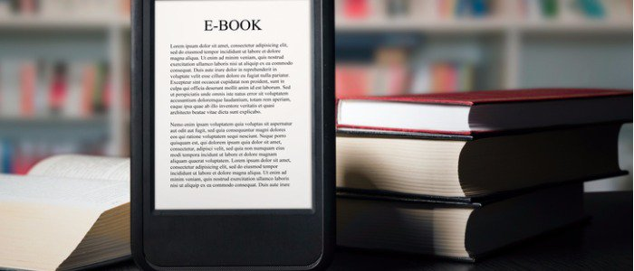 ebook-reader-device-on-desk-in-library-picture-id533457654