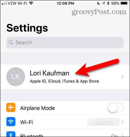 Tap your name in the Settings app in iOS